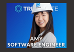 "A woman wearing a hard hat for construction, with the text ""Amy Software Engineer."""